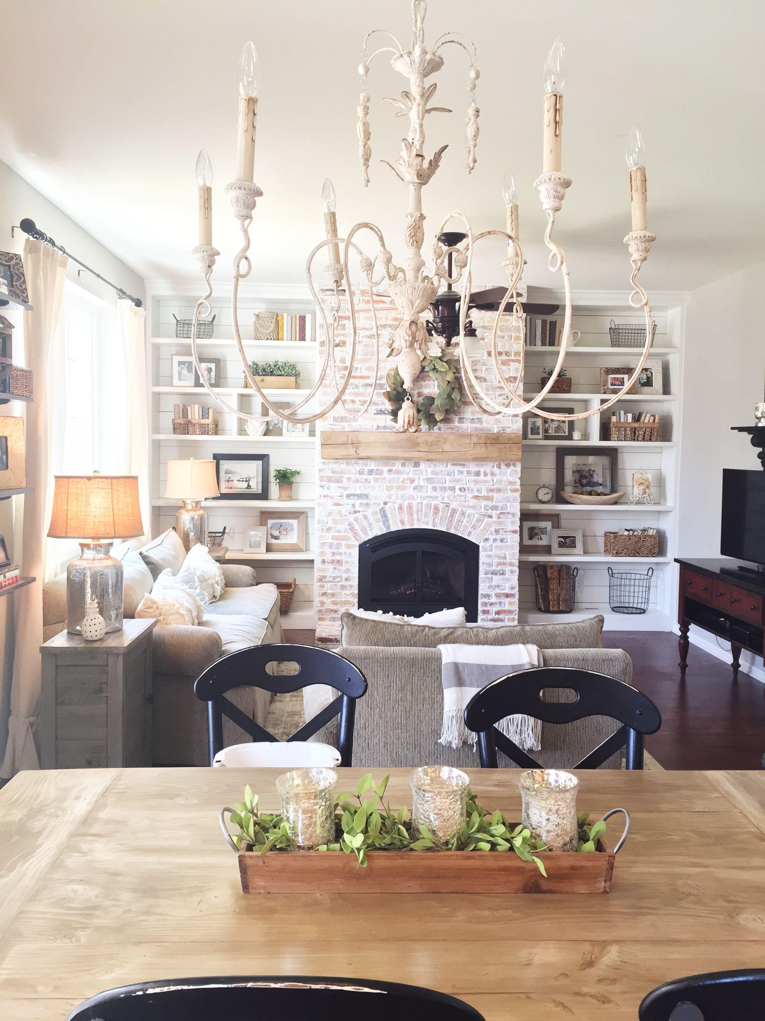 Bookshelves shiplap whitewash brick fireplace chandelier rustic
