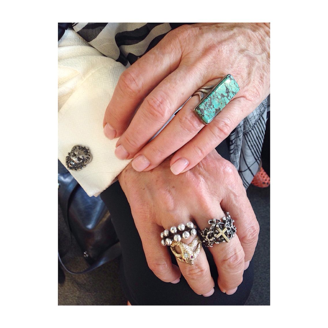 The art of mixing and layering antique jewelry perfectly demonstrated by our store owner.