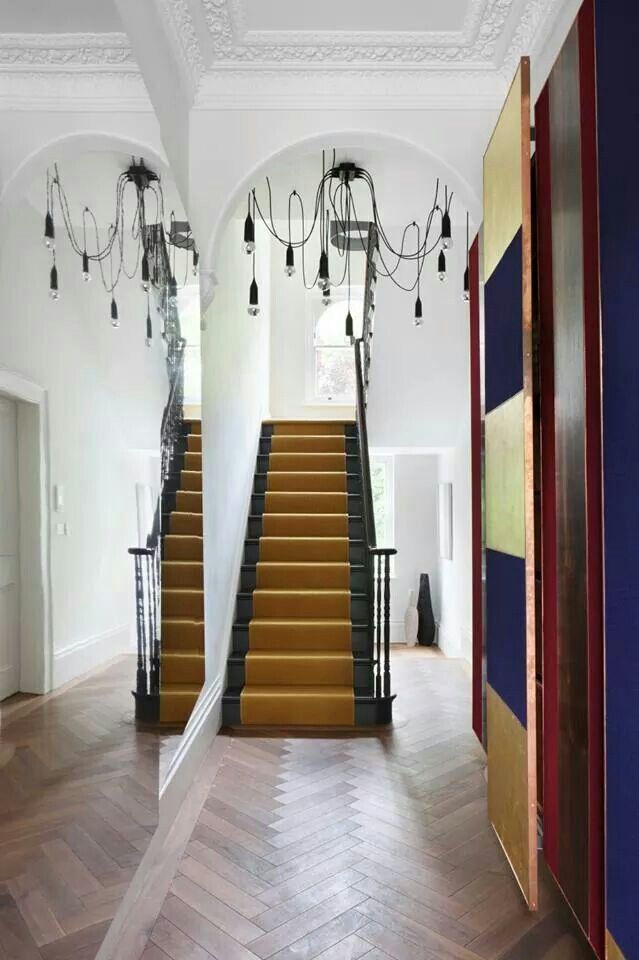 Mirror wall makes the hall look double its size. | Hallway ...