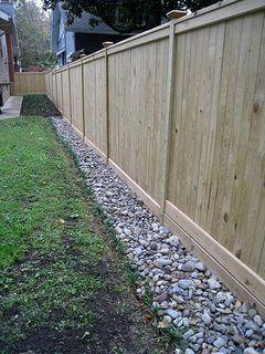 fence and stones yard drainage
