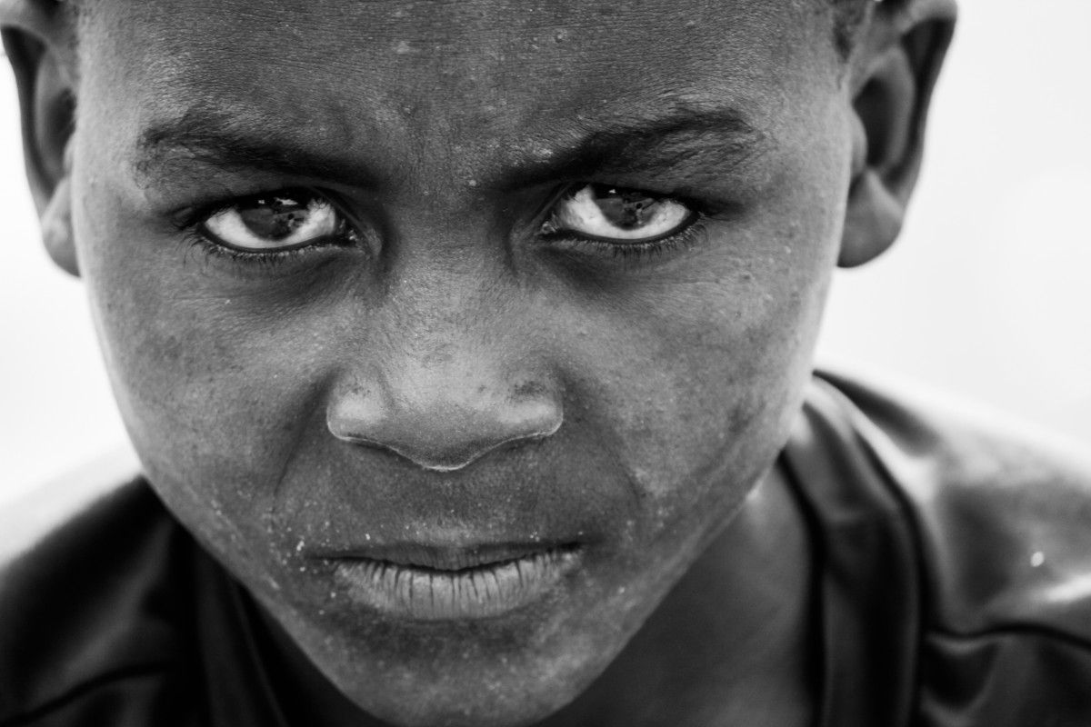 Man person black and white photography boy kid alone male portrait africa child black monochrome facial expression smile close up tribe face eye head look