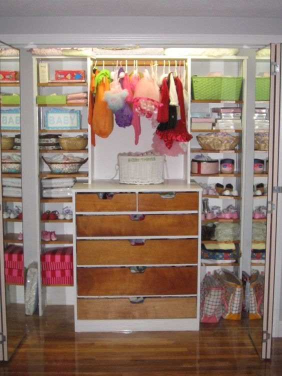 Nursery closet idea - good use of shelves and drawers for organizing baby/toddler clothes.