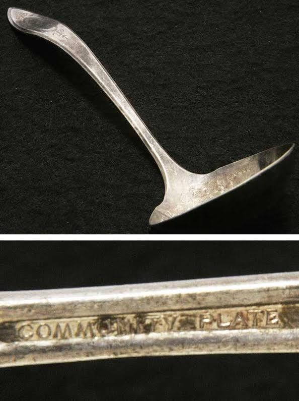 "A 1917 Oneida silverplate ladle in the ""Adam"" pattern, marked ""Community Plate."""