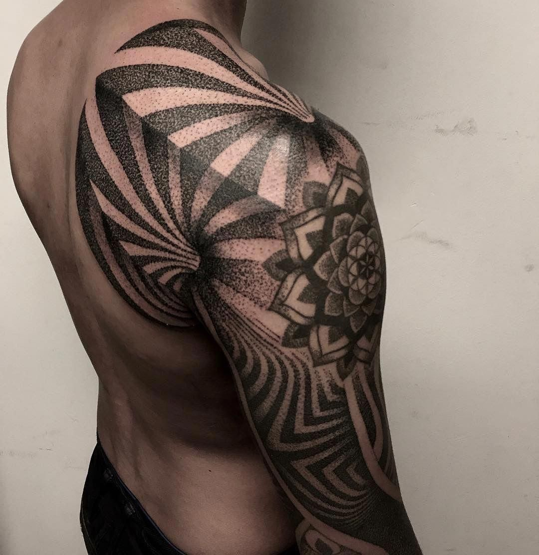 857e70163 Love this geometric tattoo sleeve which seems to have been incorporated  with some dotwork. #
