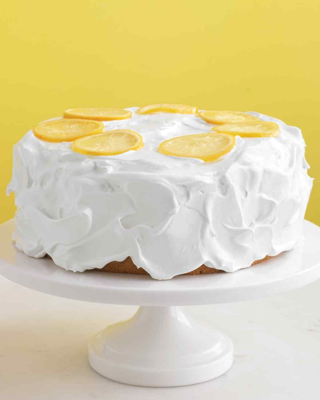 Easter Dessert Recipes | Martha Stewart Living - Basic vanilla cake gets a sunny makeover with the addition of lemon syrup, whipped frosting, and lemon slices.