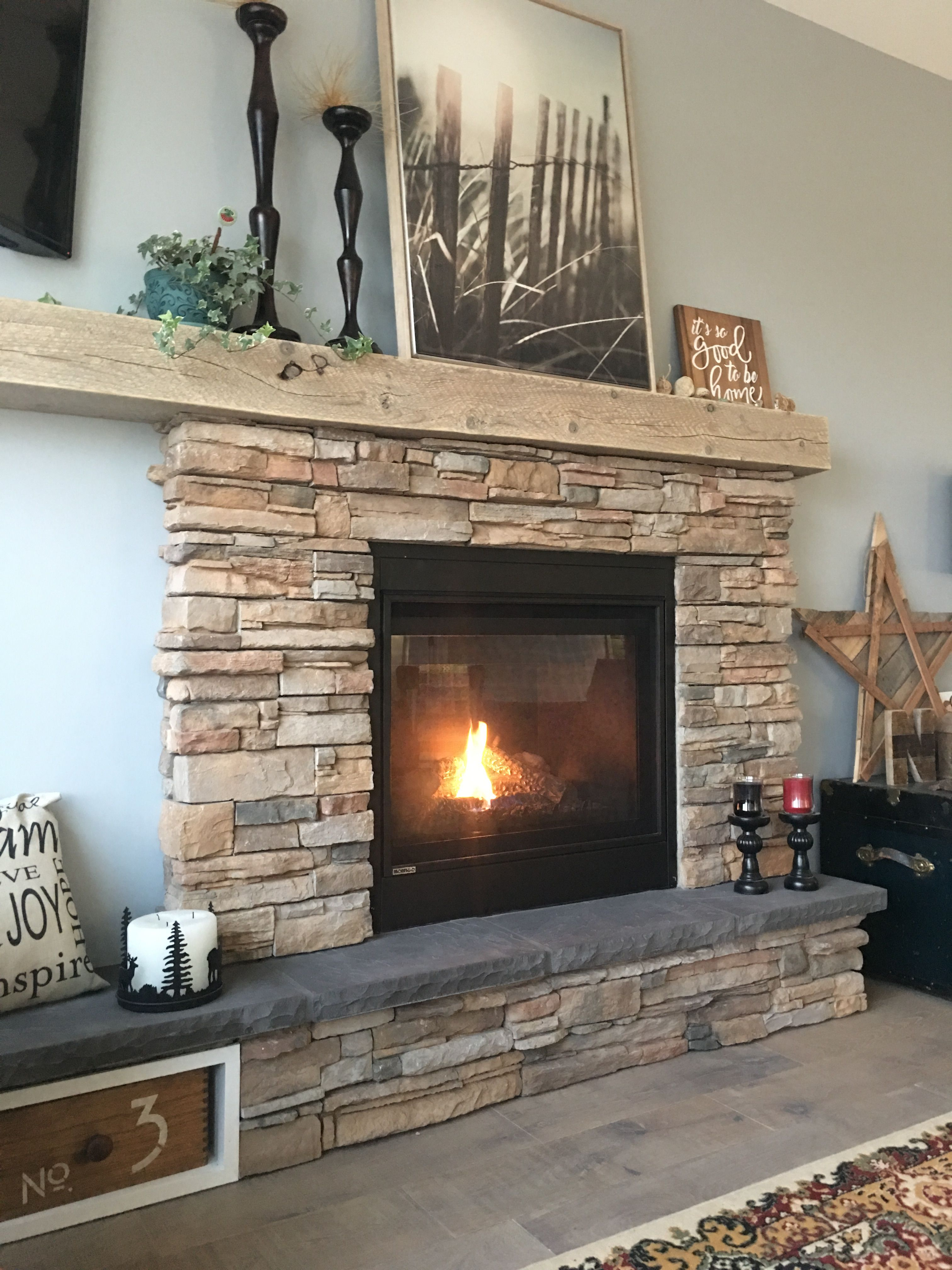 Rustic Stone Fireplace With Asymmetric Mantel And Hearth.