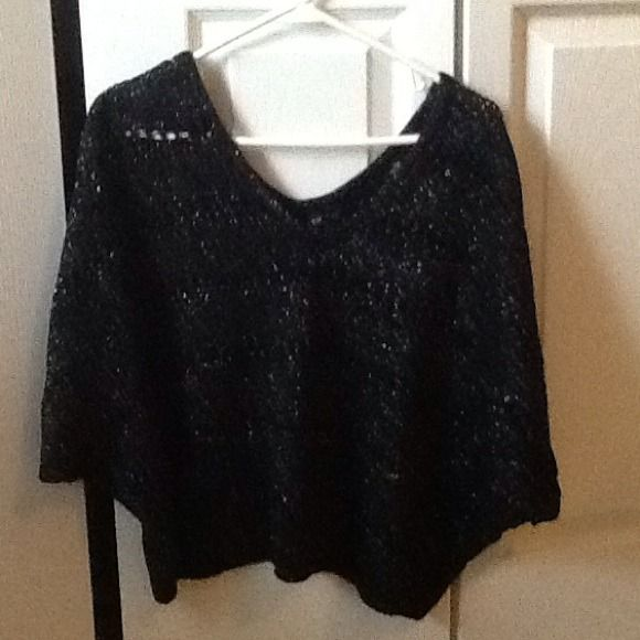 Express cropped sweater Black with silver threading crocheted cropped sweater. Can be worn off shoulder. Can see through because of the crocheting so need to wear a Cami or bandeau under Express Tops