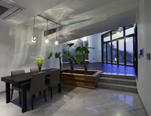 a depressed dining area inside a korean inspired house