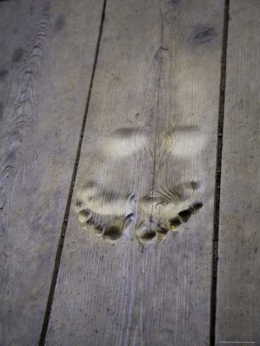 Footprints Carved In Wooden Floor Of Buddhist Temple