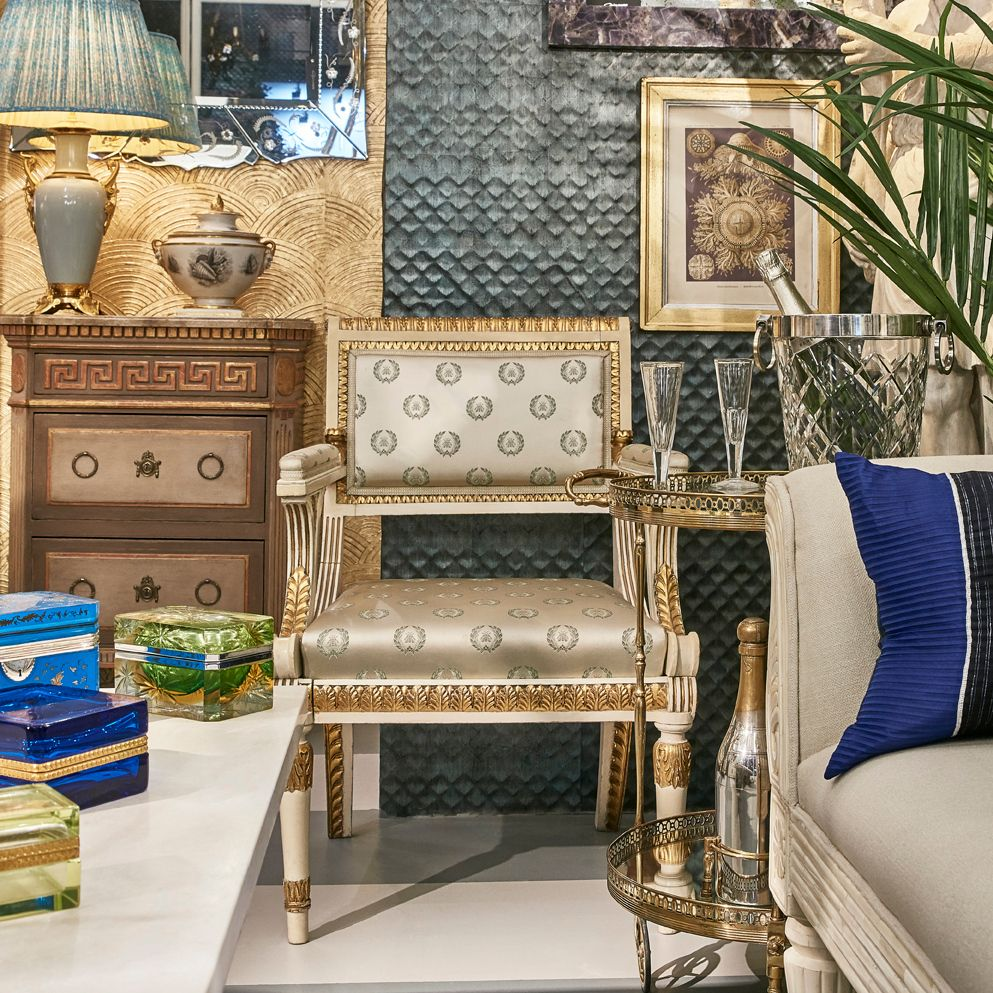 A luxurious scene with hints of gold and blue - One of a pair of 19th century parcel-gilt Neoclassical armchairs against Tatiana's 'Armada' in Azul, and her new gold 'Napa' in Midas. With splashes of blue from 20th century Murano glass boxes and Chinese Miao Skirt Fabric Cushions. #interiorinspiration #antiquefurniture #Muranoglass #antiquearmchairs