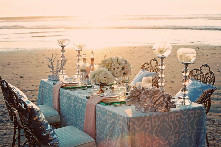 Blue wedding reception table setting on the beach | Beach wedding ...