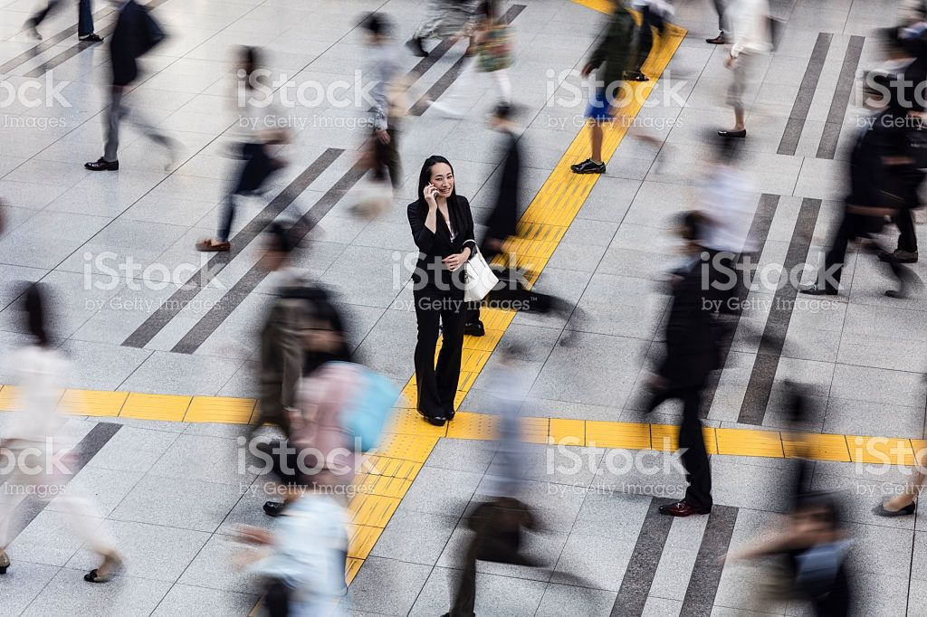 Japanese woman talking on the mobile phone surrounded by