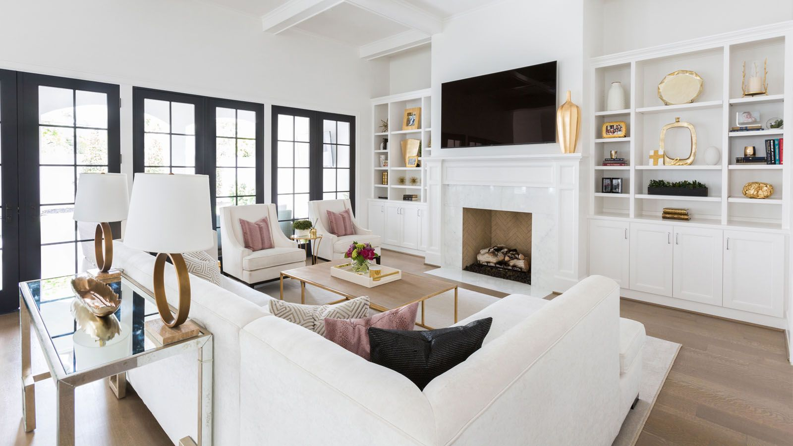 white and bright living space with over the fireplace tv laura u interior design decor. Black Bedroom Furniture Sets. Home Design Ideas