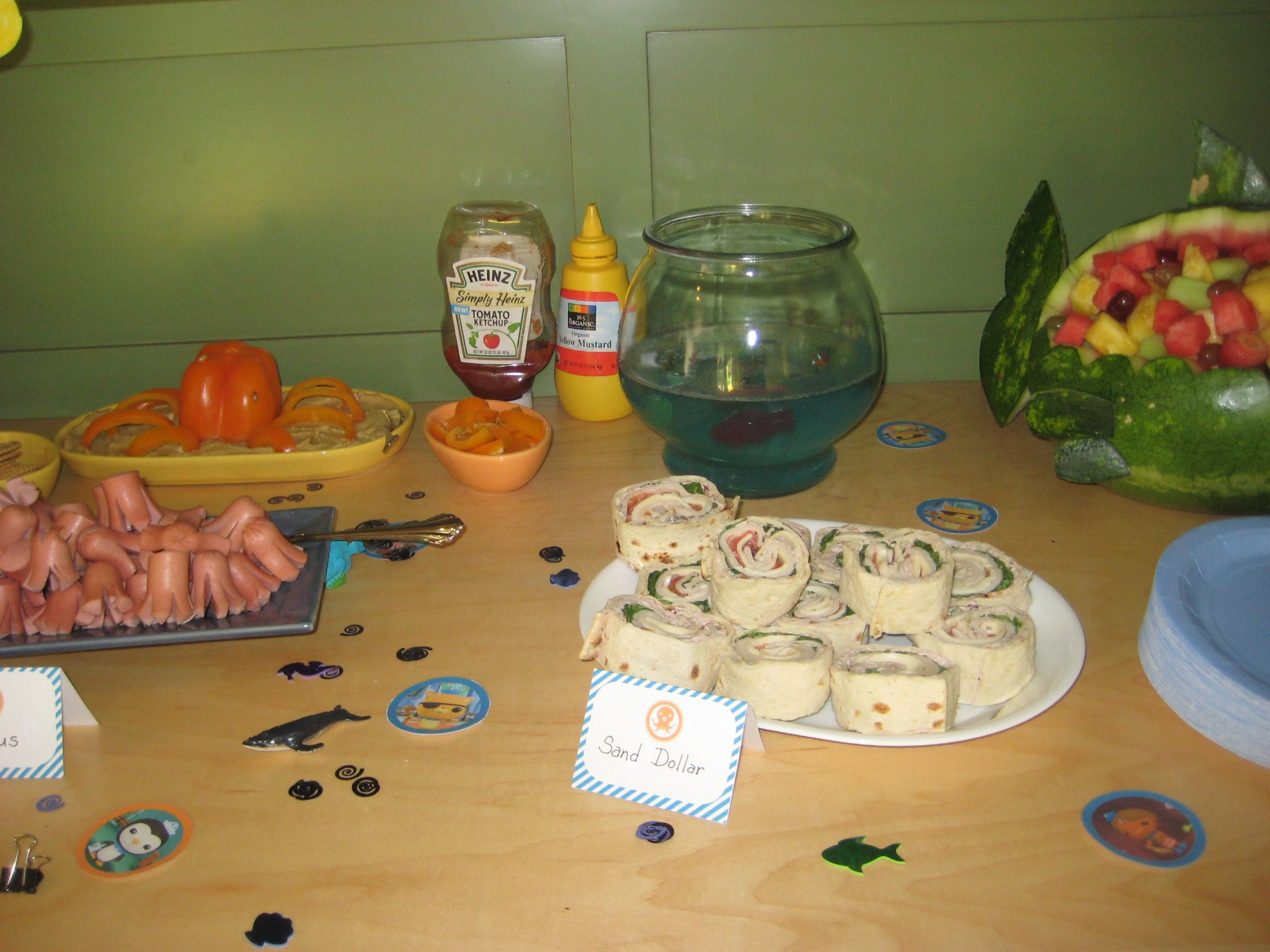 fish food buffet - octapus bell pepper on hummus, sand dollars (roll-ups), hot dog squid