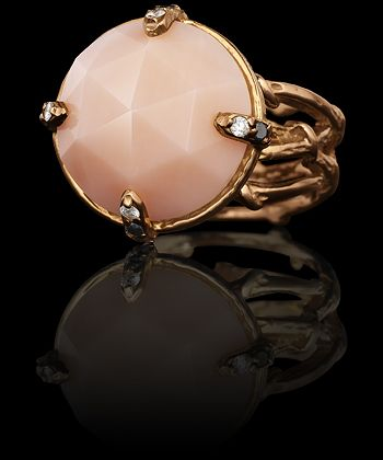 """SPELLBOUND  The """"Spellbound"""" ring features a custom-cut, hand-carved onyx round faceted cabochon stone set on a quadruple-vine ring with twining vines wrapping around the band and pave diamond claws. Shown in hand-textured 18k rose gold, pink coral with colorless and black diamonds pave. 0.06 carat total.  $4,200"""