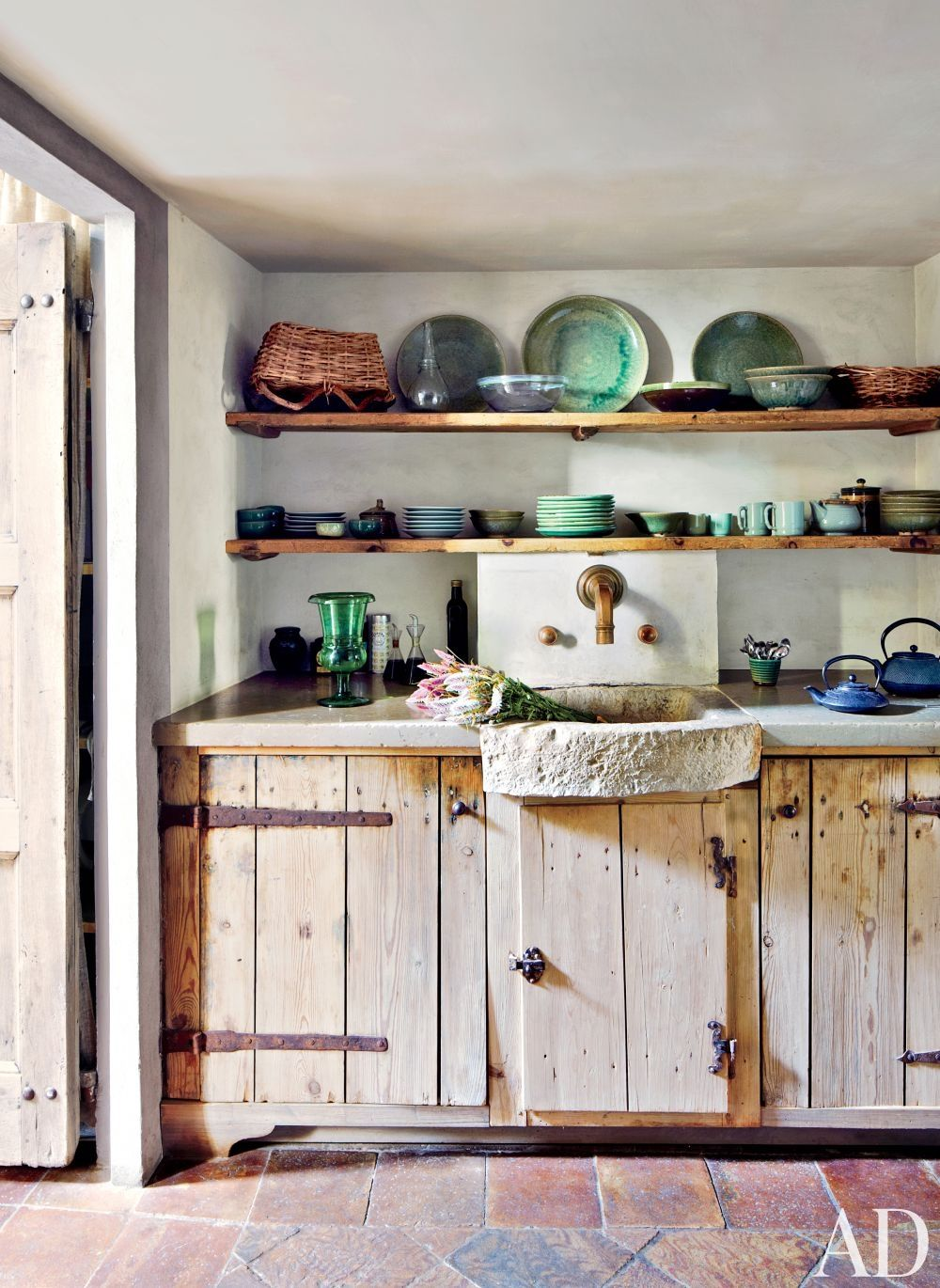 In the kitchen of a Rome apartment, a cabinet is made of reclaimed 17th-century wood.