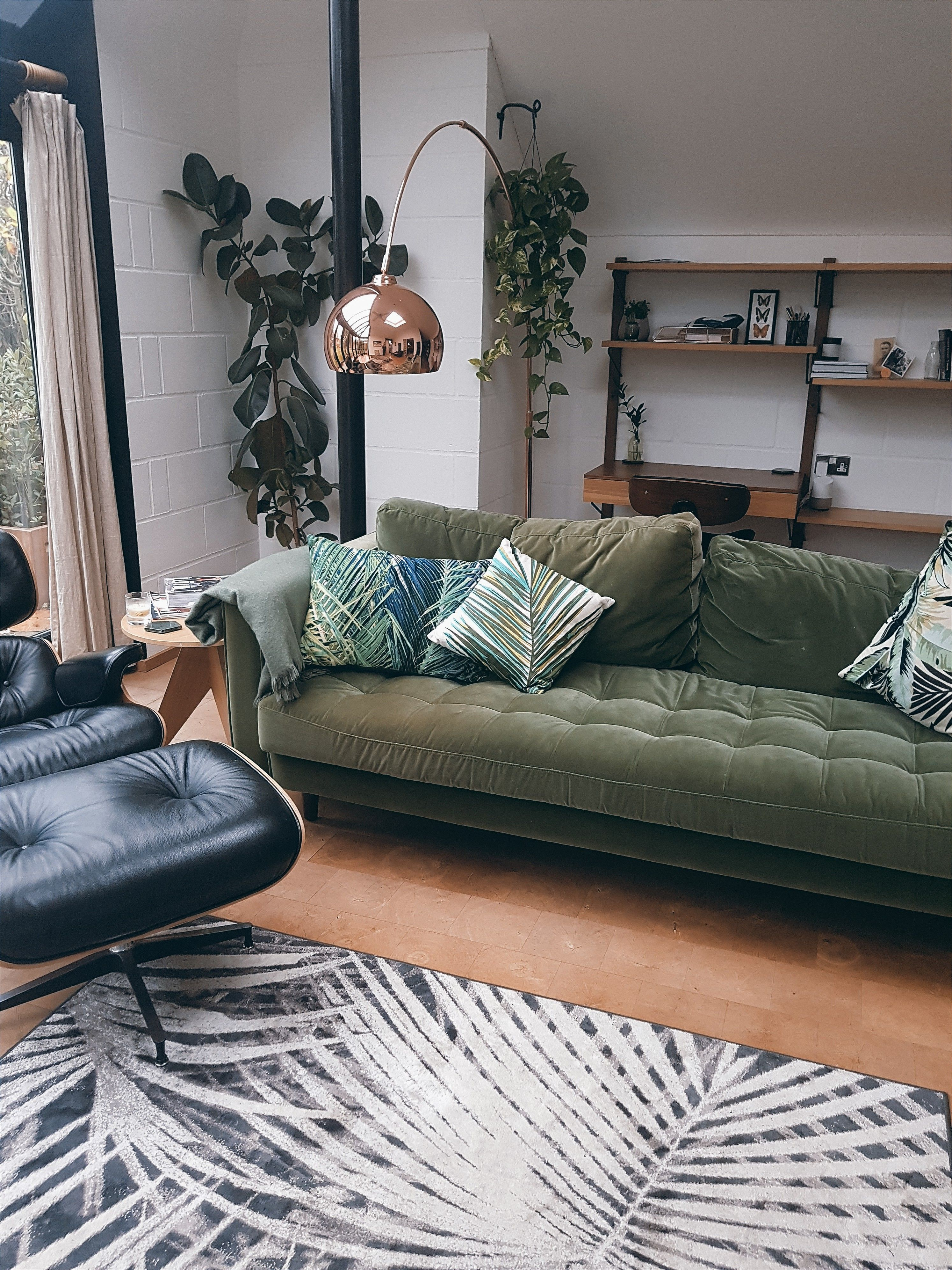 The Plants And Shelving In The Background Small Living Room Furniture Minimalist Living Room Open Living Room Design Home living room background
