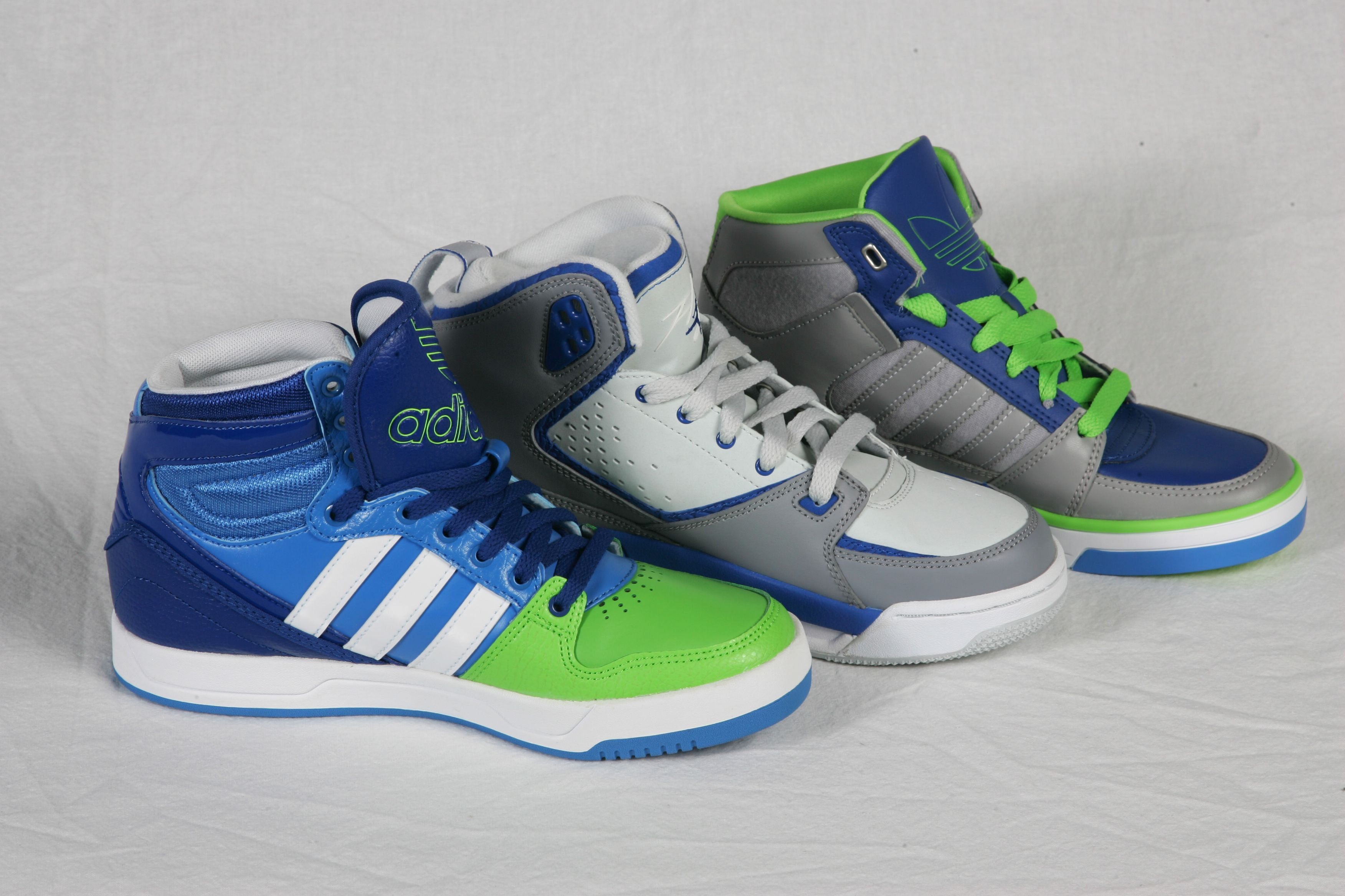 grey and green adidas high tops