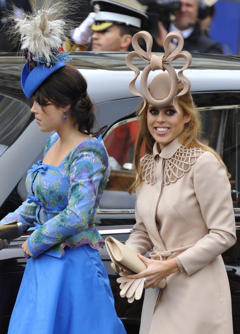 78617145346a8e Princess Beatrice and sister, Princess Eugenie, at the Royal Wedding. Both  wearing Philip Treacy hats
