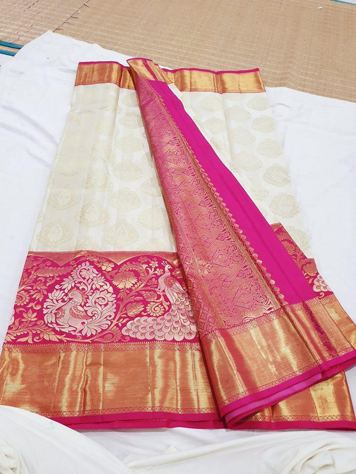 Photo of Kanchipuram bridal wedding saree in off white and pink with contrast zari border