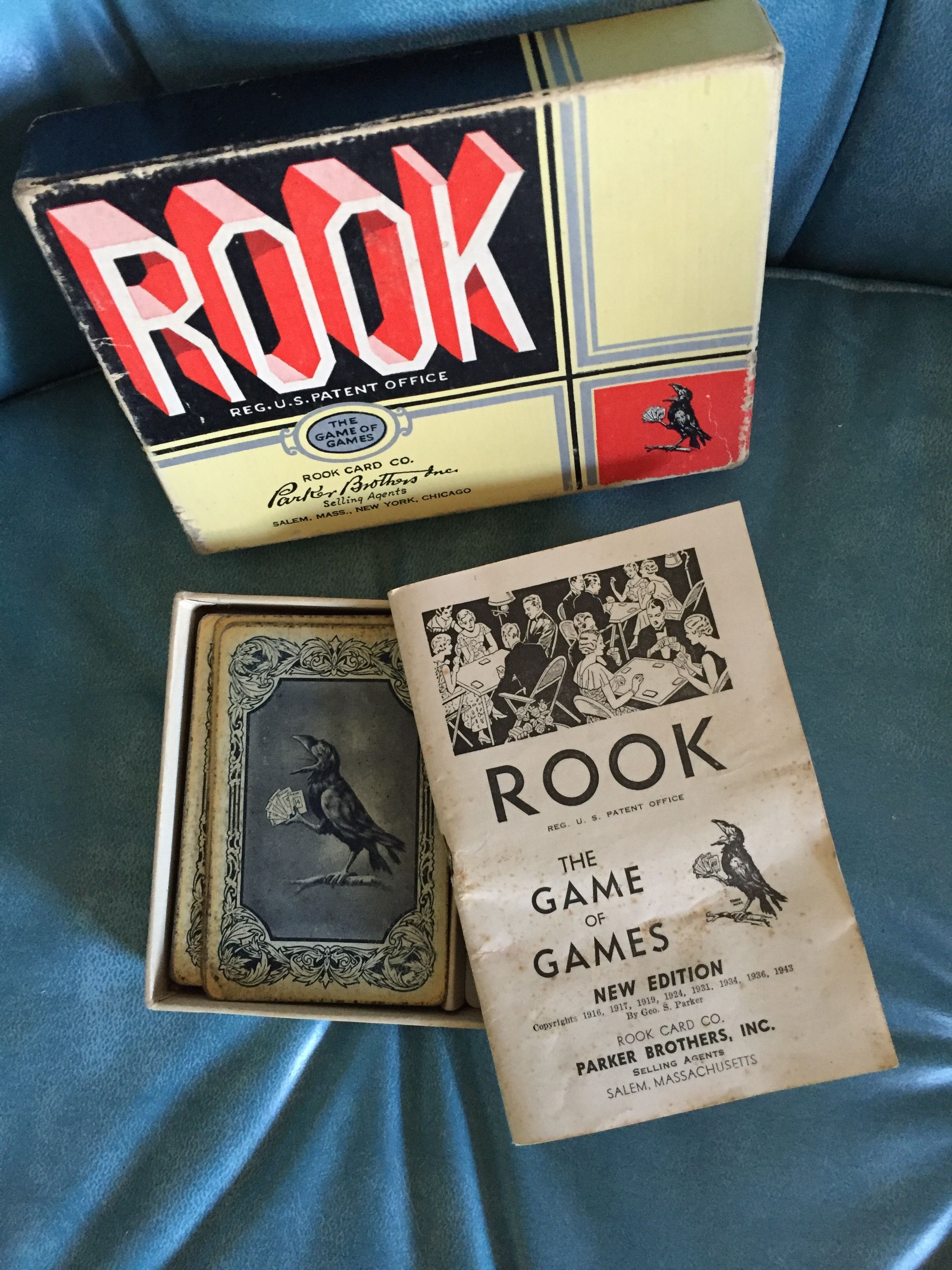 Box of old rook cards with instructions rook cards