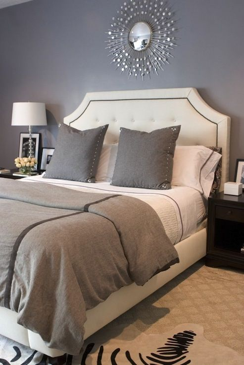 bedrooms - Restoration Hardware Delano Bed white tufted nailhead trim bed gray duvet blanket pillows silver sunburst mirror gray walls paint color bedroom zebra cowhide rug