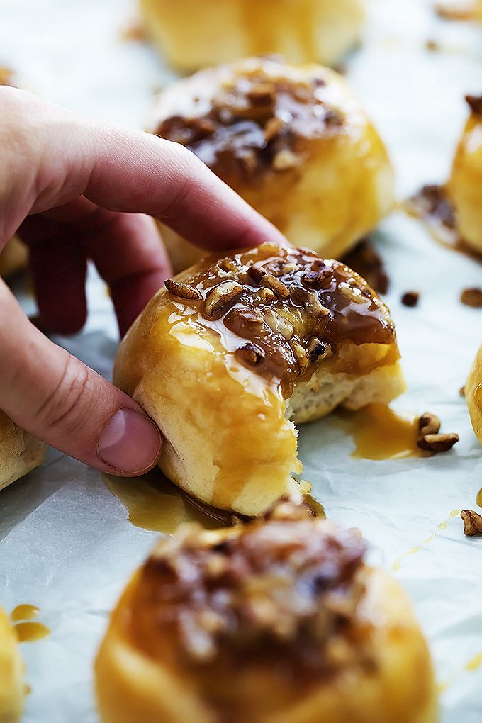 Ooey gooey mini caramel sticky buns made with only 4 ingredients and ready in just 20 minutes! These tasty little breakfast buns are amazing!! #stickybuns