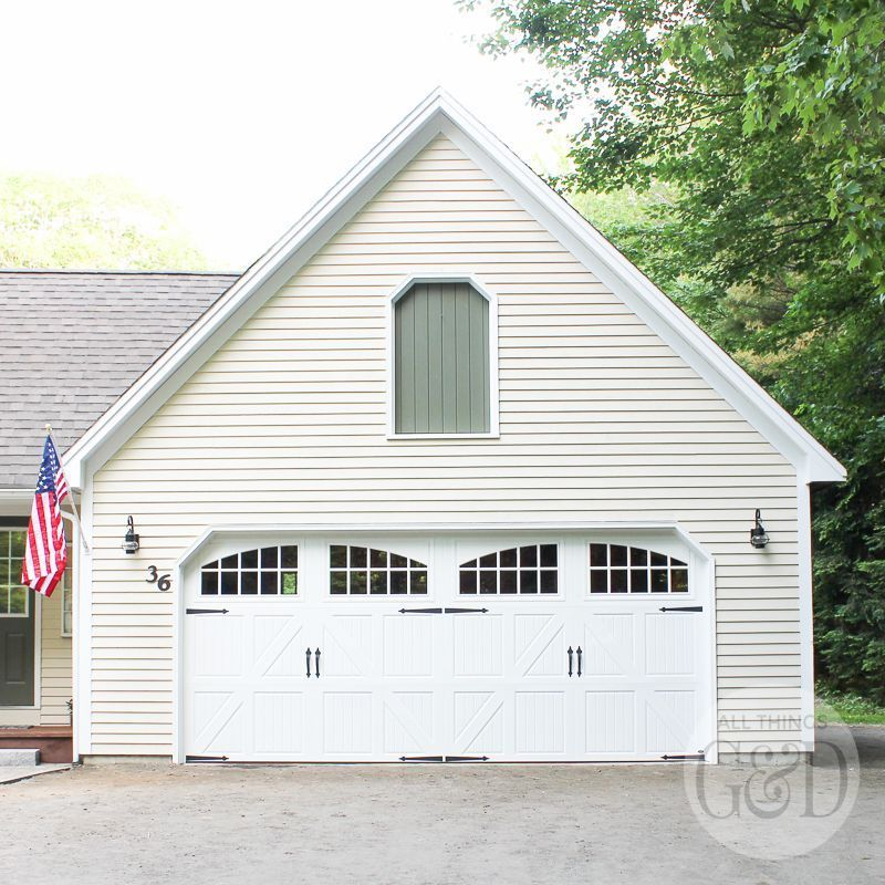 This Pella Carriage House Series White Double Garage Door