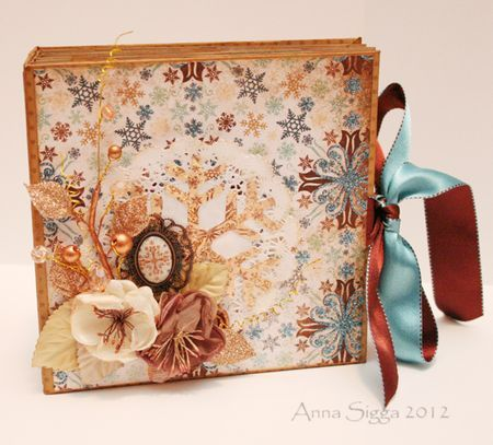 Ideas for a winter mini.  She used doilies on the  pages as mattes.  Great work of art.