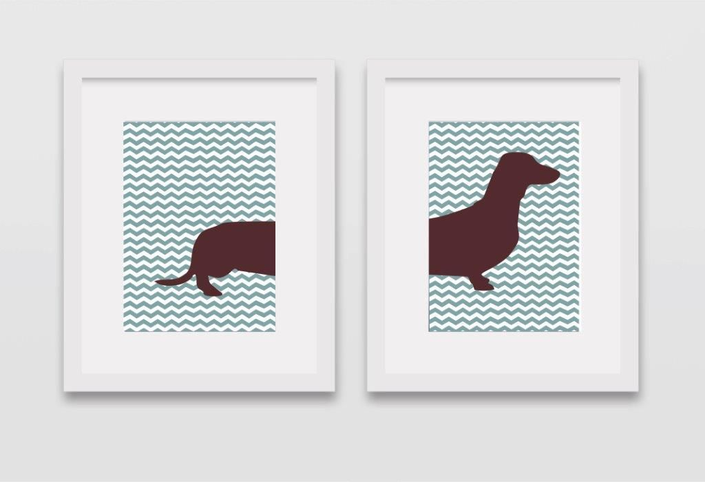 Dachshund print – Blue green zigzag background – set of two framed in white frame Size of Frames: 34cm X 44cmm Product description - Print This print has bold bright colours with a white border and a flat white modern frame. Beautiful for any room in the home Price: R230 per framed print