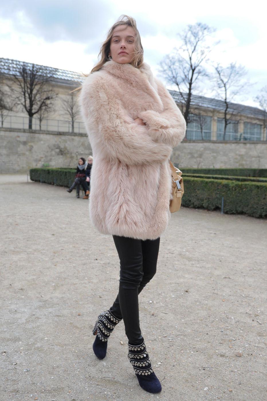Karmen Pedaru, wearing a pink fur + leather leggings + studded Alaia boots #fashion #streetstyle #modeloffduty