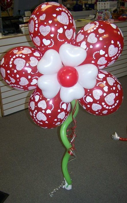 Red hearts latex Balloon Flower.  www.itspartytimeandrentals.com