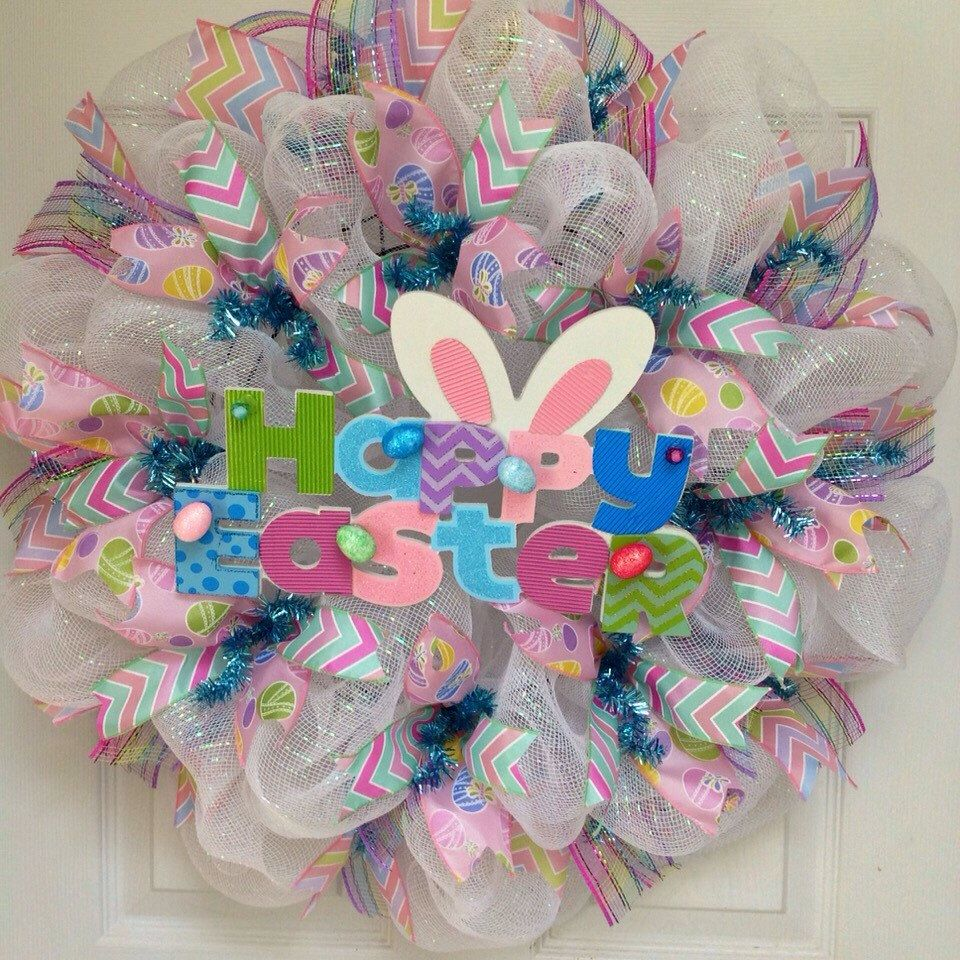 A personal favorite from my Etsy shop https://www.etsy.com/listing/226195696/happy-easter-wreath-with-adorable-bunny