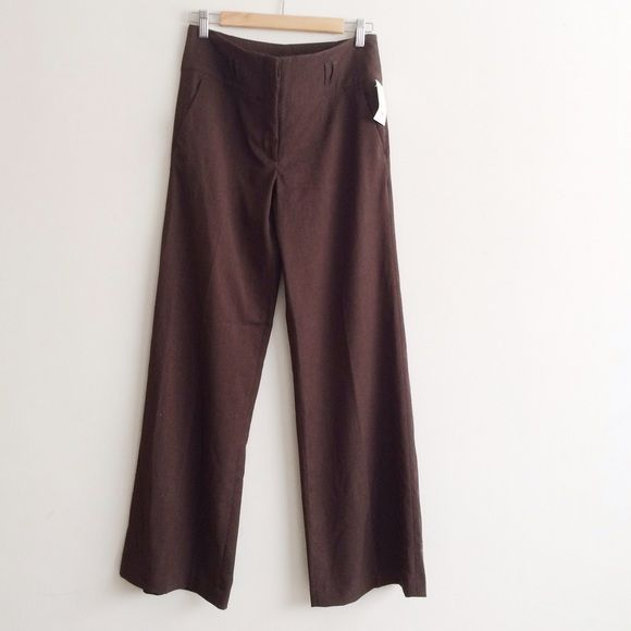 """H&M Brown Wide Leg Trousers Brand new with tag! Be part of the trend and look incredibly chic in these wide leg trousers.  65% polyester, 33% viscose, 2% elastane. Laid flat, waist is 14 1/2"""", rise is 9 1/2"""", inseam is 31 1/2"""", purse am is 40"""", cuff is 11"""". H&M Pants"""