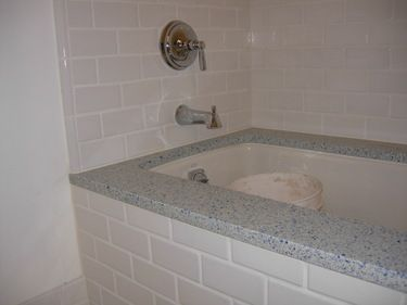 Ice stone tub topper adds class over the standard acrylic for Cast iron vs acrylic tub