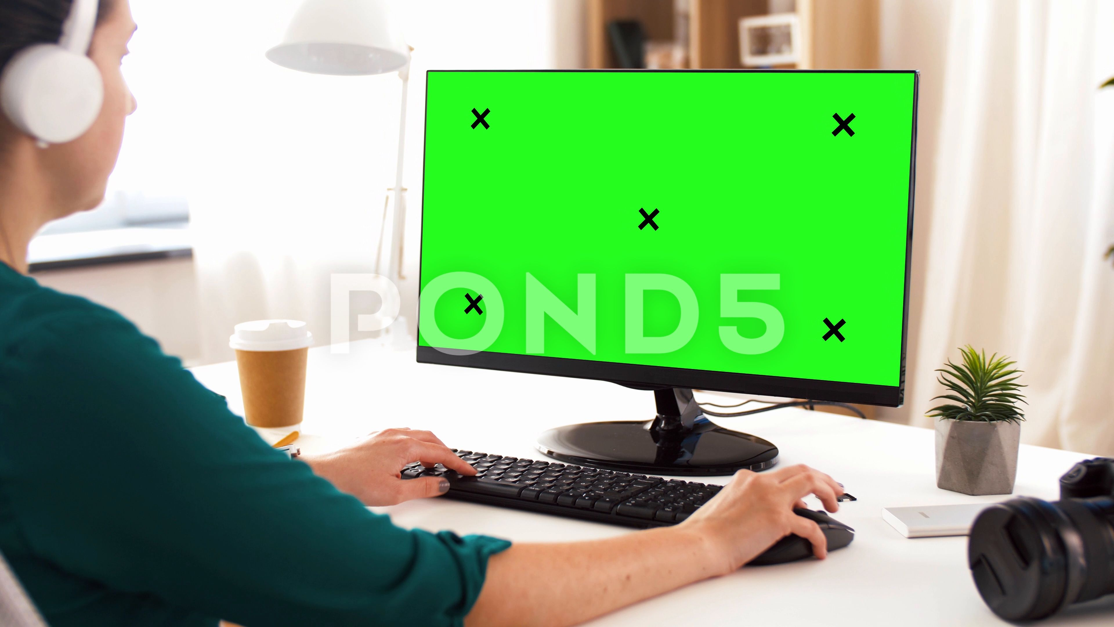 Woman with green screen on computer at home Stock Footage