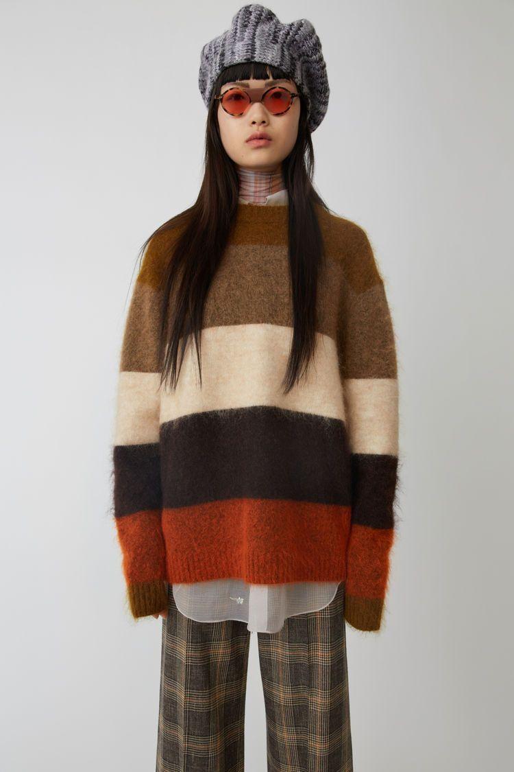 85c6bb071af Acne Studios orange multi is a classic striped sweater.