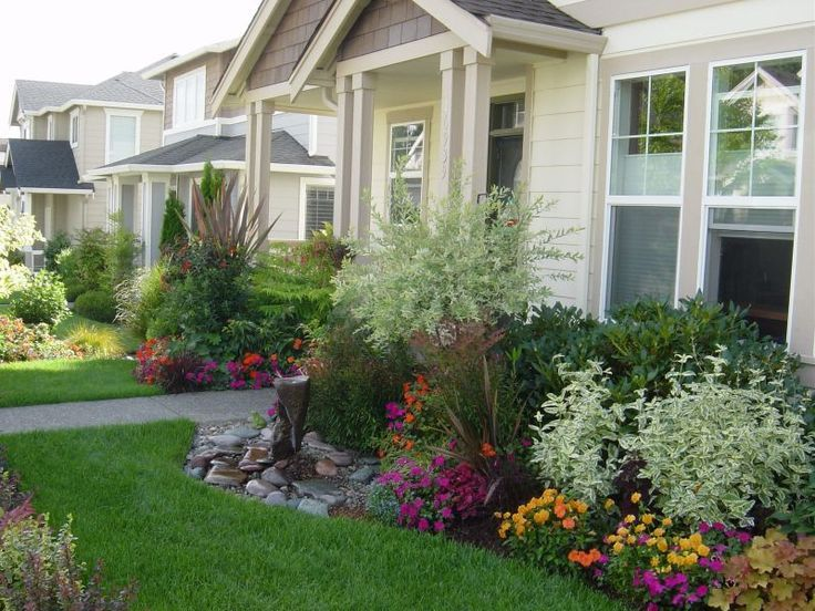 Lots Of Color Shrubs Relatively Low Under Windows Also A Small Water Feature And Smooth Rocks