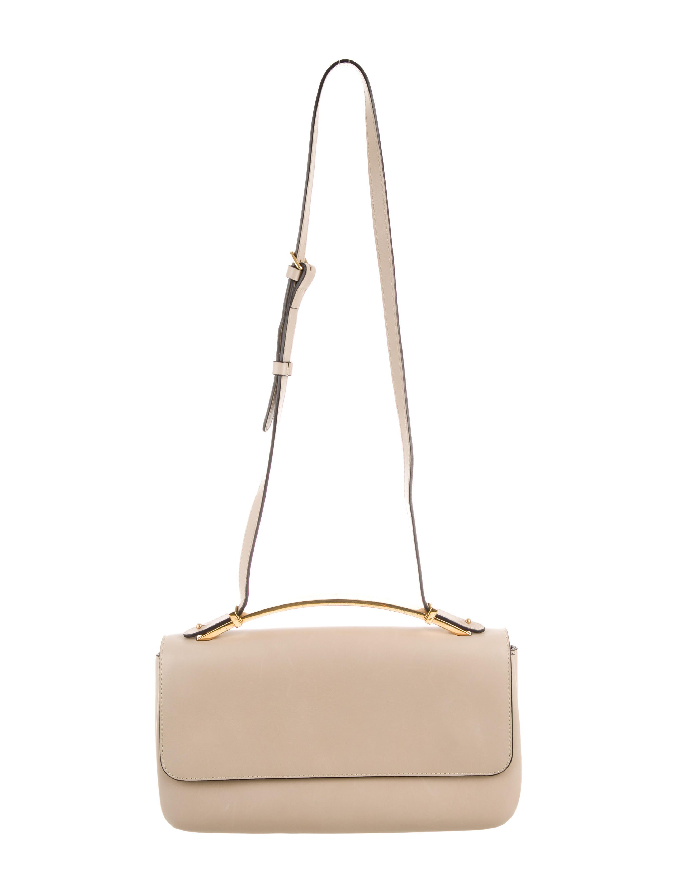 Tan leather Marni shoulder bag with gold-tone hardware, tonal stitching throughout, adjustable strap, beige canvas lining, three compartments and dual snap closures at front flap. Includes dust bag. Shop authentic designer handbags by Marni at The RealReal.