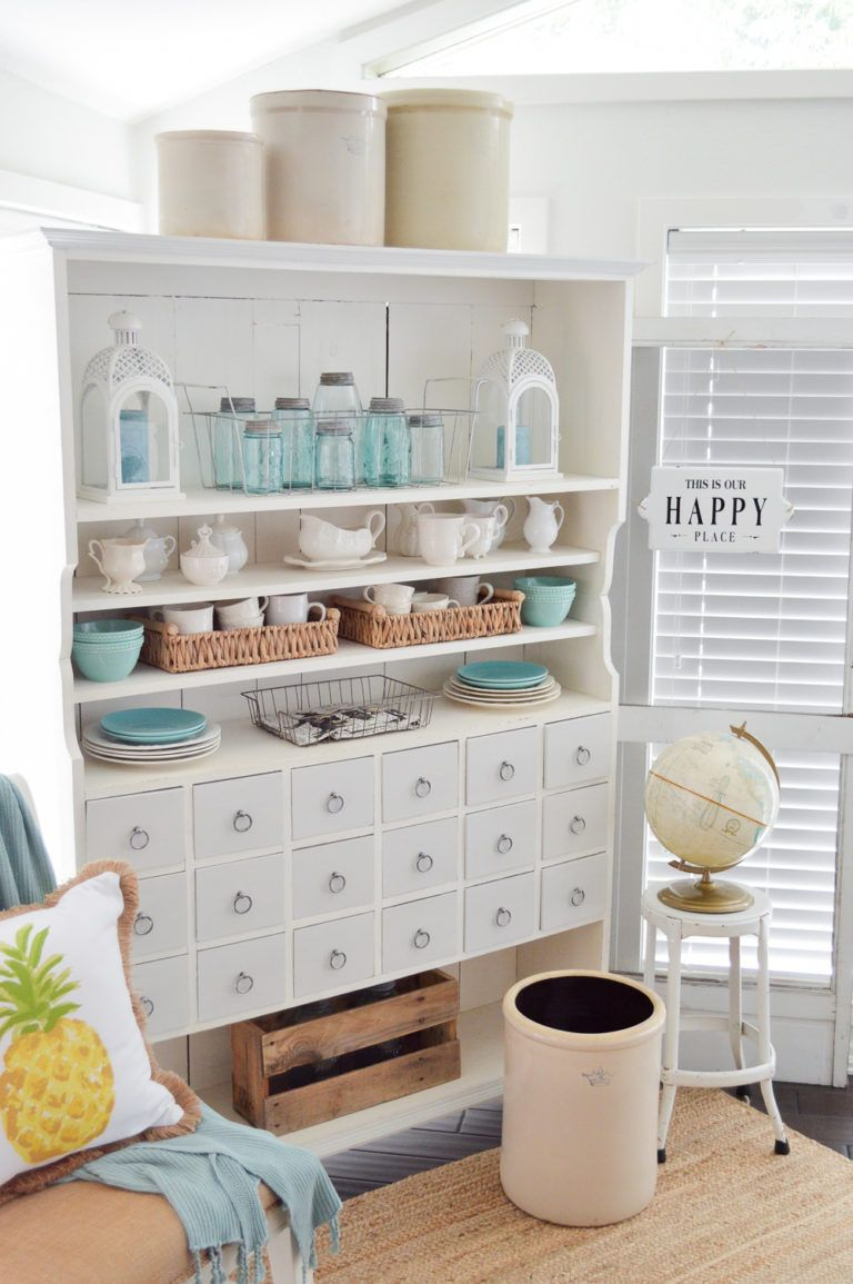 Simple Summer Decorating Ideas & Home Tour - welcome to our casual cottage living & dining room, decorated in neutral colors and zingy lemon! #farmhousestyle #cottagestyle #sunroom #apothecarycabinet #openconcept #bhg #hometour #decoratingideas #summerdecor #vintagecrocks #balljars