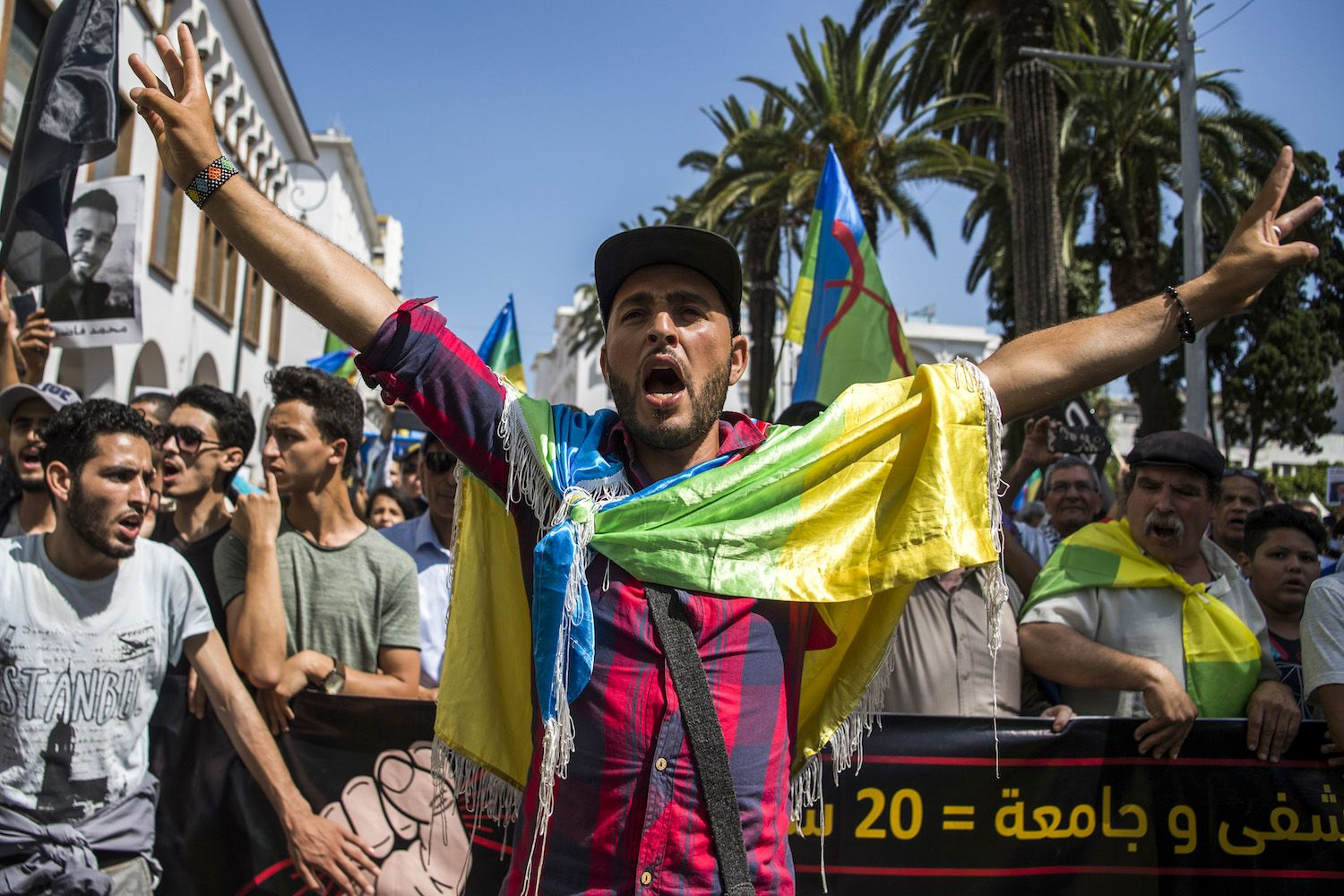 A Moroccan Draped In The Berber Or Amazigh Flag Shouts Slogans While Marching During A Protest Against The Jailing Of Al Hirak Or Popu Morocco Rabat Silence