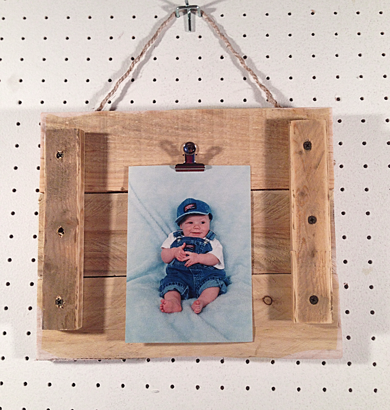 Picture frames are handmade with pallet wood and adorned with rustic ...