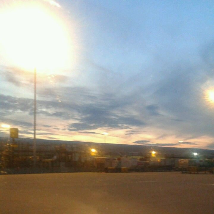 Sunset over the cargo sheds near the can racks @ Manchester Airport