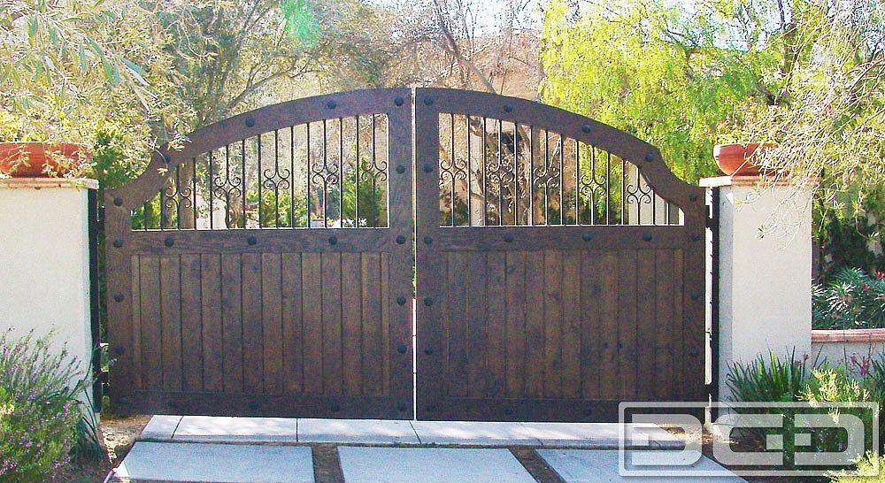 Dynamic garage door custom motorized driveway gates for Wooden driveway gate designs