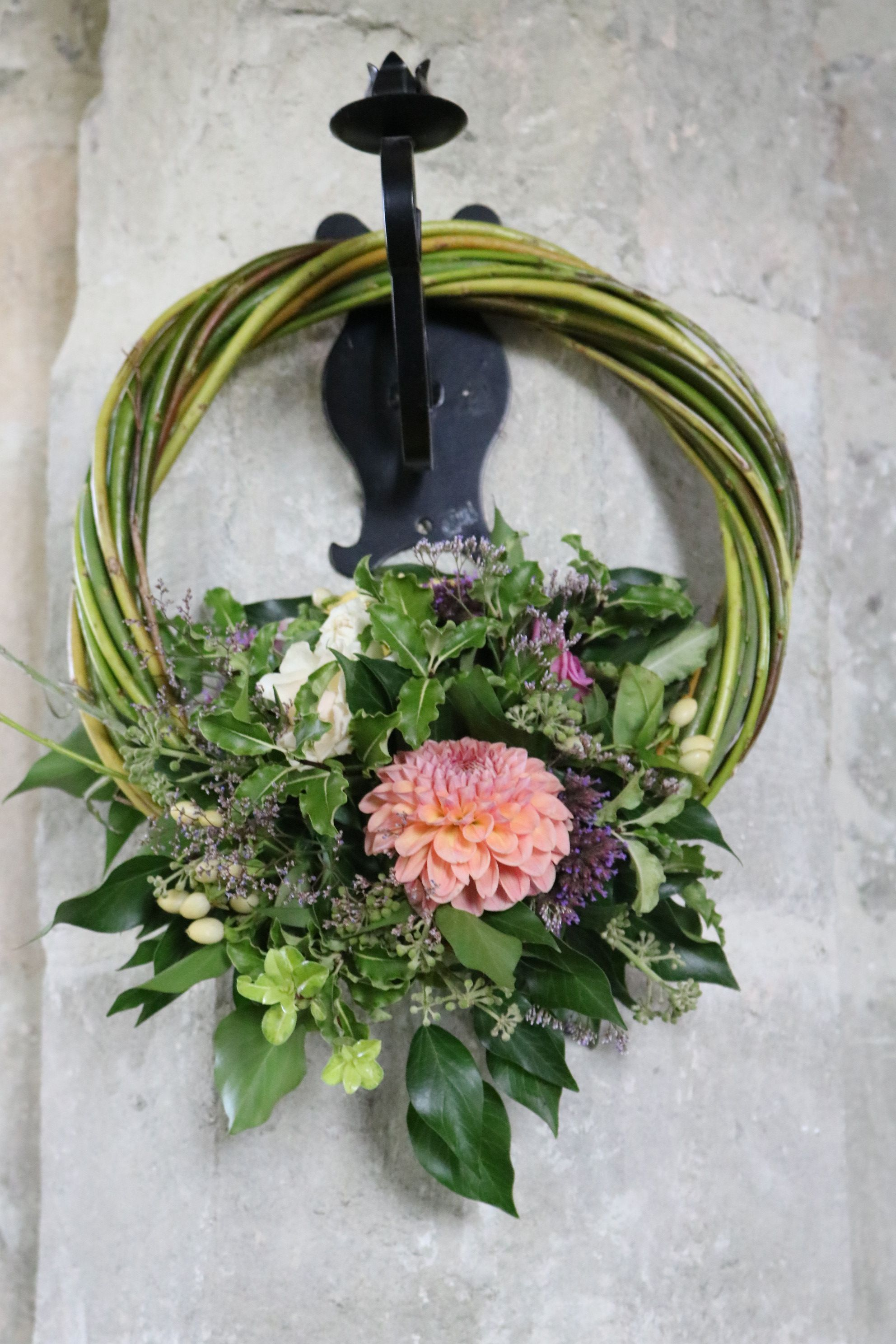 Fresh Somerset willow wreath dressed with flowers and
