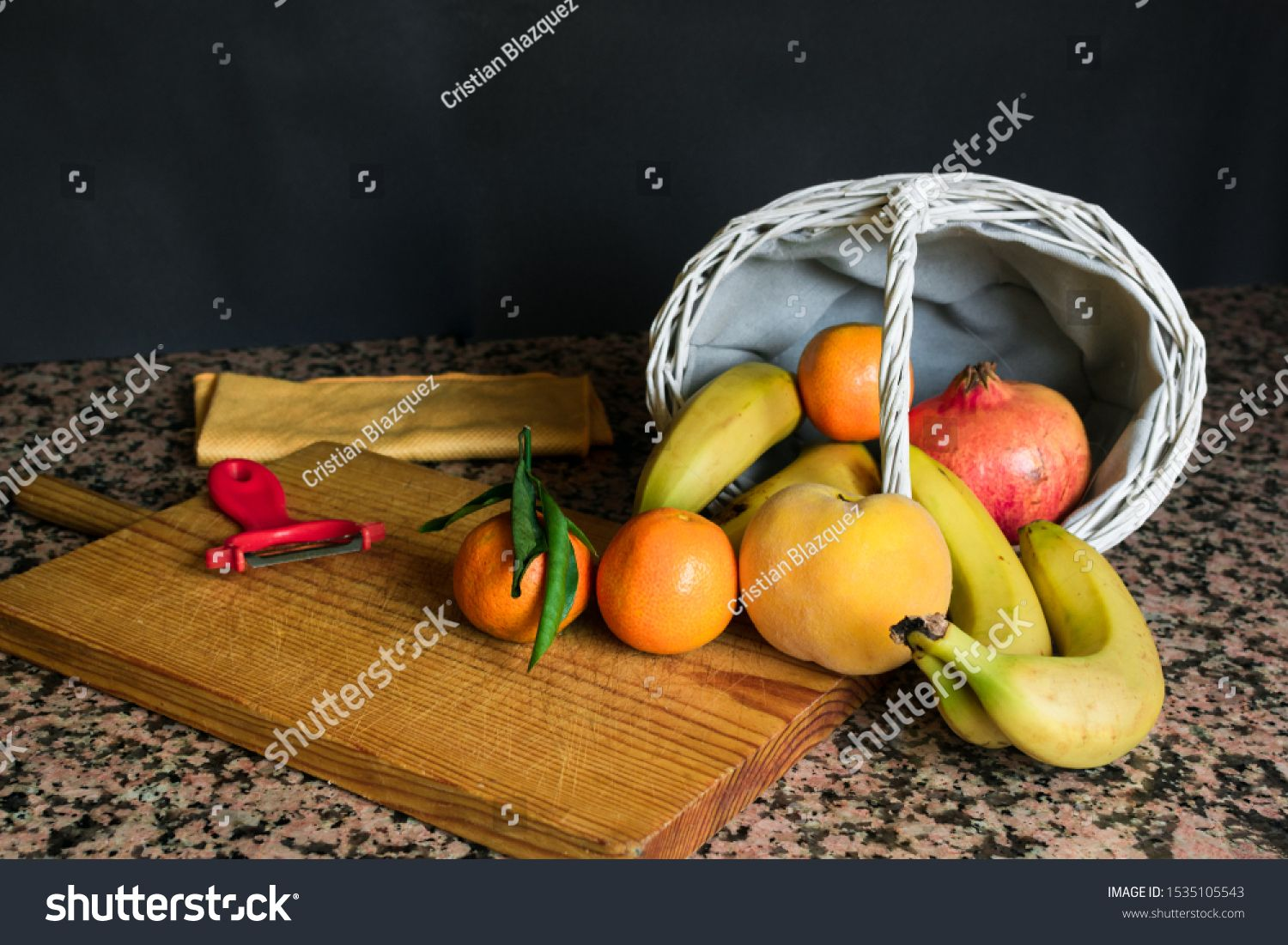 Stock photo of a fruit still live with a white basket and