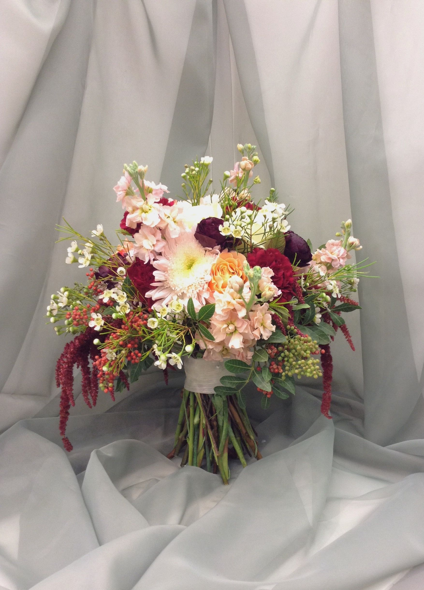 Blush Sangria And Peach Bridal Bouquet With Roses Ranunculus Stock Amaranthus Pepper Berry And Wax Flowe Bridal Bouquet Bridal Bouquet Peach Wax Flowers