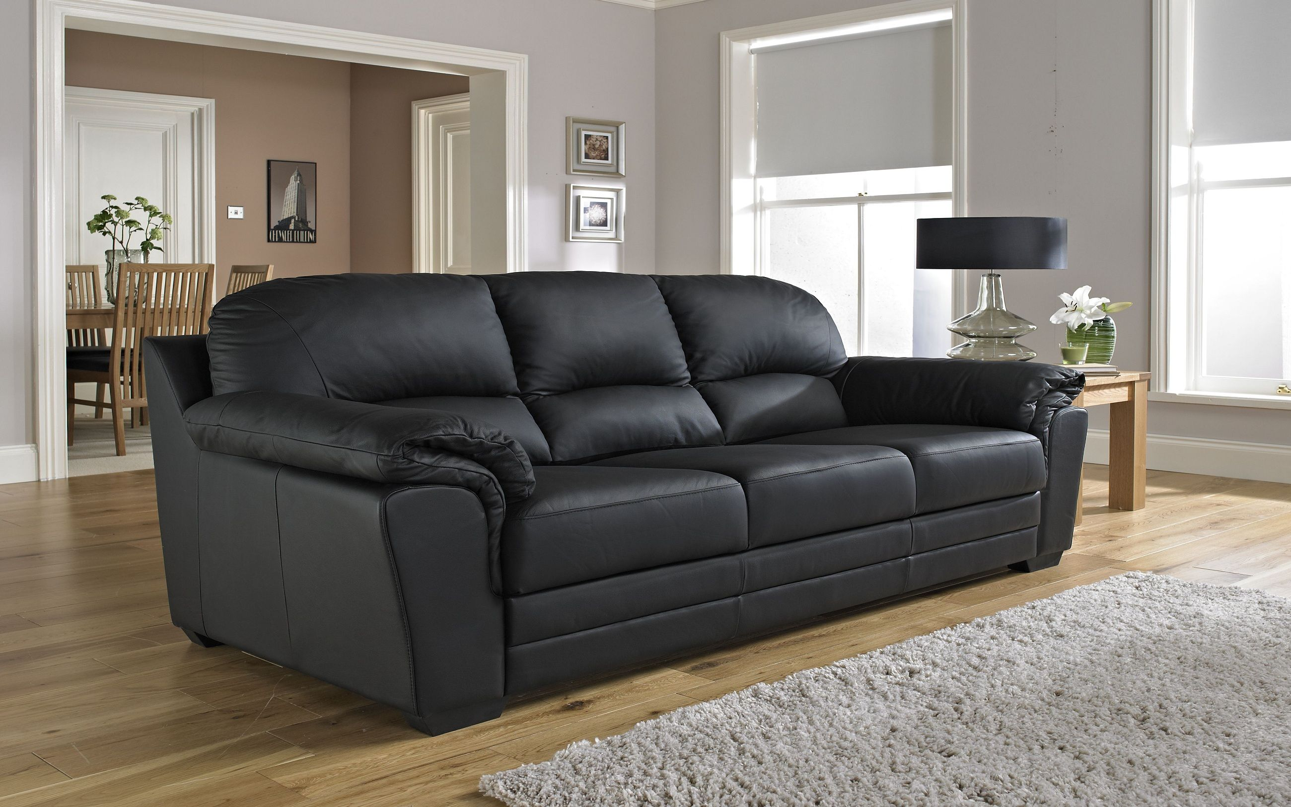 black sofa with wooden table - Black Sofa