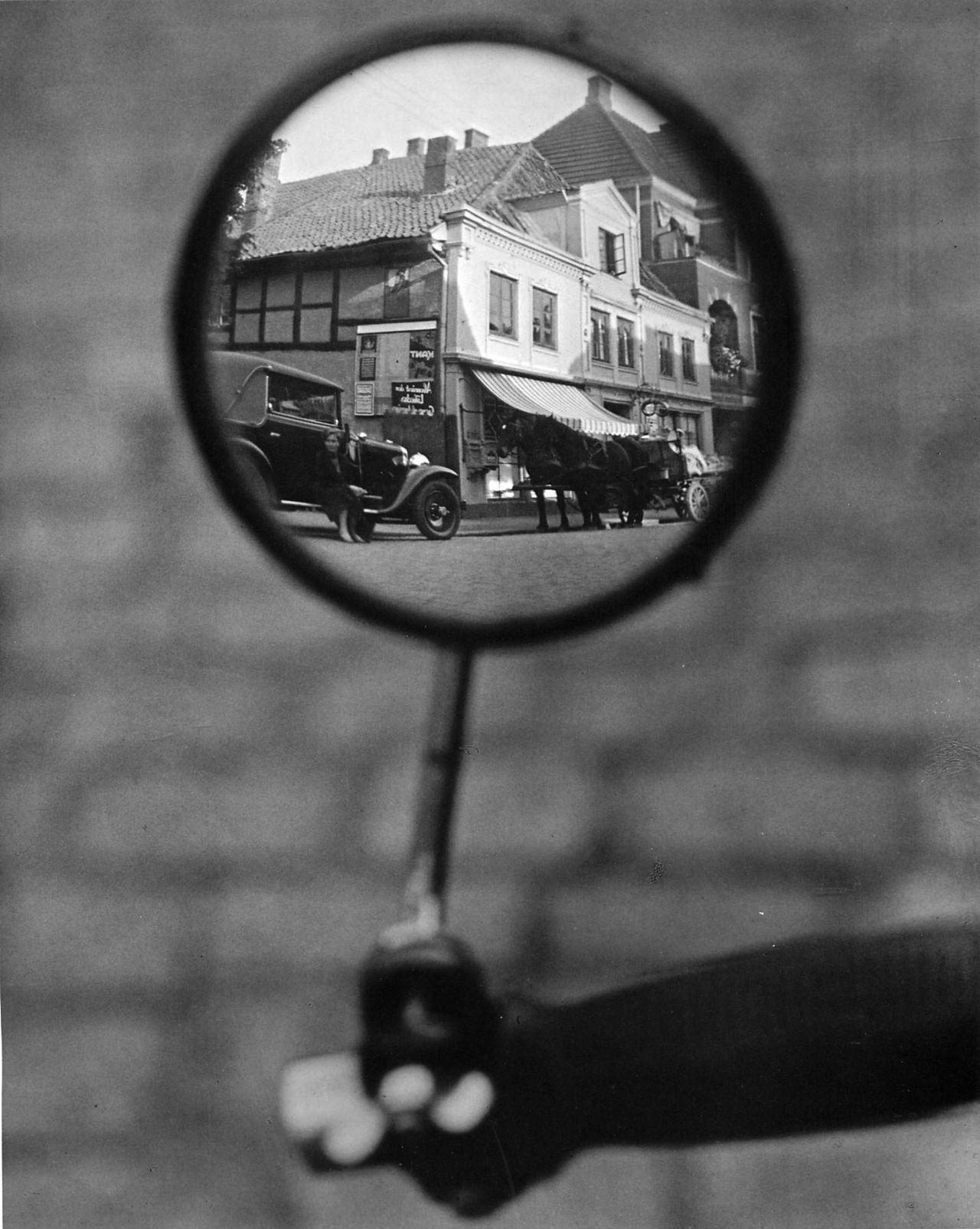 Martin munkacsi reflection in a motorcycle mirror berlin for Mirror reflection