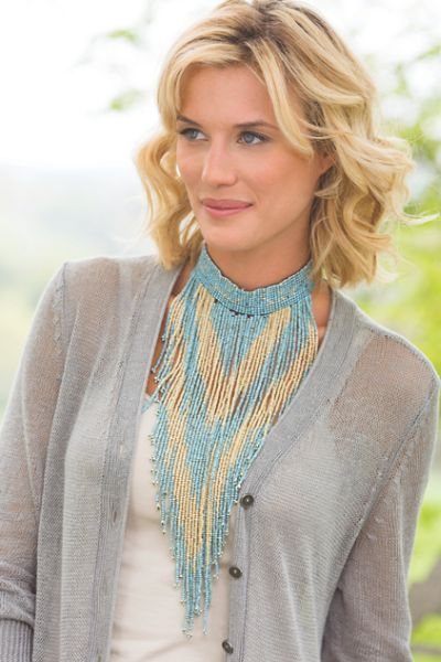 Turn up the drama on any outfit with our Hinto Necklace! Hundreds of glass beads flow from a slender band in a chic chevron pattern to add an artisan flair to your most basic tank.